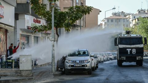 Turkish anti-riot police use a water cannon to disperse protesters on October 26, during a demonstration against the detention of the Kurdish-majority city's co-mayors in Diyarbakir.