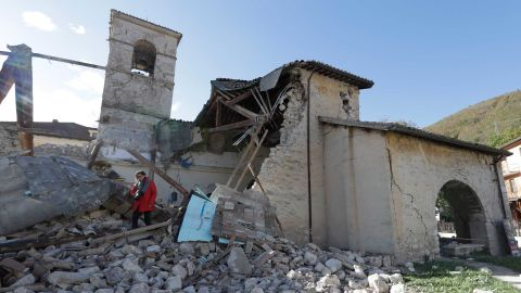 """A woman walks among debris at the Church of St. Antony, dating from the 14th century, in the town of Visso on Thursday, October 27, after a pair of earthquakes rocked central Italy. A magnitude 5.5 quake struck Wednesday, October 26, followed hours later by a magnitude 6.1 temblor. No deaths were reported, but historic buildings were damaged in the region where a powerful <a href=""""http://www.cnn.com/2016/08/27/europe/italy-earthquake-amatrice-perugia/"""">quake killed nearly 300 people</a> in August."""