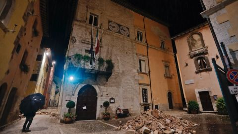 People wander around Visso on October 27 after the quake destroyed part of their neighborhood.