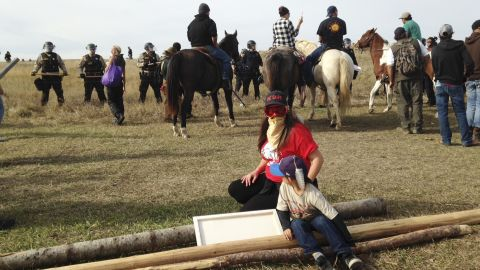 Protesters resist efforts to be moved from a camp in the path of pipeline construction Thursday.