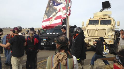 Dakota Access pipeline protesters defy law enforcement officers who are trying to force them from a camp on private land in the path of pipeline construction on Thursday, Oct. 27, 2016, near Cannon Ball, N.D. The months-long dispute over the four-state, $3.8 billion pipeline reached a crisis point when the protesters set up camp on land owned by pipeline developer Energy Transfer Partners. The disputed area is just to the north of a more permanent and larger encampment on federally-owned land where hundreds of protesters have camped for months.