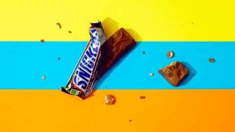 For a standard 52.7-gram Snickers, one plus one-fifth of a bar equals 33 grams of sugar.