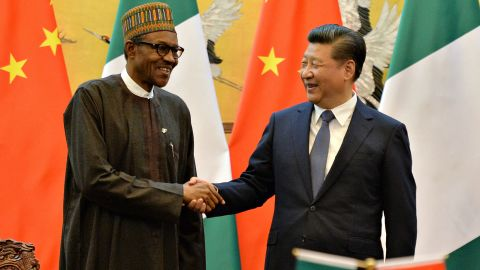 Nigerian President Muhammadu Buhari and Chinese President Xi Jinping shake hands during a signing ceremony at the Great Hall of the People, Beijing, in April, 2016.