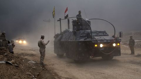 An Iraqi Federal Police vehicle passes through a checkpoint in Qayara, some 31 miles, 50 km, south of Mosul, Iraq, Wednesday, Oct. 26, 2016. Islamic State militants have been going door to door in farming communities south of Mosul, ordering people at gunpoint to follow them north into the city and apparently using them as human shields as they retreat from Iraqi forces. Witnesses to the forced evacuation describe scenes of chaos as hundreds of people were driven north across the Ninevah plains and into the heavily-fortified city, where the extremists are believed to be preparing for a climactic showdown. (AP Photo/Marko Drobnjakovic)