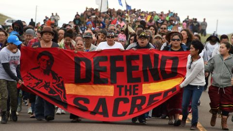 Native Americans march to the site of a sacred burial ground that was disturbed by bulldozers building the Dakota Access Pipeline on September 4, 2016 near Cannon Ball, North Dakota.