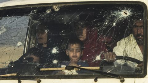 Iraqi families displaced by fighting between Iraqi forces and ISIS flee their home Saturday.