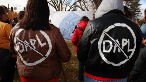 Cousins Jessica and Michelle Decoteau take part in a protest outside the North Dakota state capitol in Bismarck on October 29.