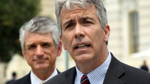 """WASHINGTON, DC - MAY 16:  U.S. Rep. Joe Walsh (R-IL) (R) speaks as Rep. Scott Rigell (R-VA) (L) listens during a news conference to announce the formation of the 'Fix Congress Now Caucus' May 16, 2012 on Capitol Hill in Washington, DC. A group of bi-partisan congressional members have formed the caucus hoping to """"prohibit members of Congress from receiving pay after October 1 for any fiscal year in which Congress has not approved a concurrent resolution on the budget and passed the regular appropriations bills.""""  (Photo by Alex Wong/Getty Images)"""