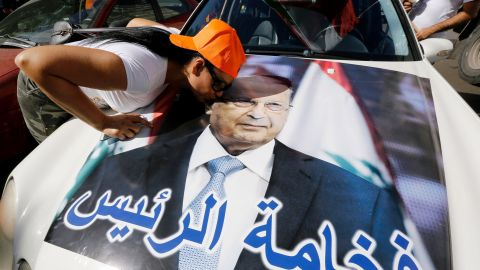 A woman kisses a portrait of Michel Aoun as revelers celebrate Monday on the outskirts of Beirut.