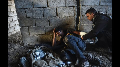 An Iraqi counterterrorism soldier injured during clashes with ISIS fighters on the edge of Mosul.