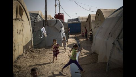 Children play in a camp for internally displaced people near Kirkuk, Iraq, on October 30. More than 600 families from Tel Afar, a town west of Mosul, have been living in the camp since ISIS took control of the area in 2014.