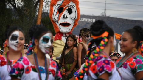 People in costume gather for the annual Dia de los Muertos, or Day of the Dead, festival at the Hollywood Forever cemetery in Hollywood, California, on October 29, 2016. Dia de los Muertos is a festival to remember friends and family members who have died and originated in Mexico.