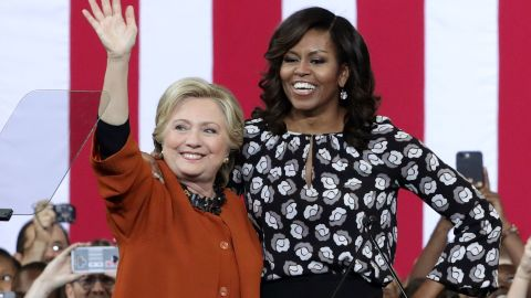 Clinton and Obama greet supporters during a campaign event in Winston-Salem, North Carolina on October 27, 2016
