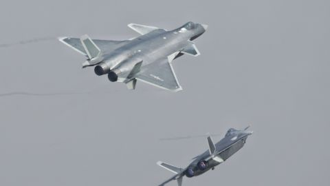 J-20 stealth fighters of the Bayi Aerobatic Team of PLA's (Peoples Liberation Army) Air Force perform on Tuesday in their first public appearance.