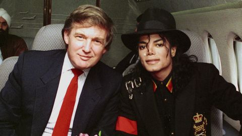 Trump and singer Michael Jackson pose for a photo before traveling to visit Ryan White, a young child with AIDS, in 1990.