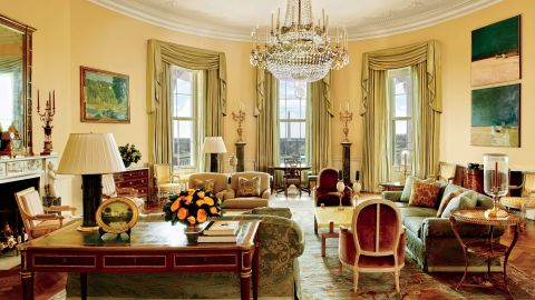 """The image provided by Architectural Digest shows the Yellow Oval Room in the White House in Washington in a cover story about . Designer Michael S. Smith specified a Donald Kaufman paint for the Yellow Oval Room. Artworks by Paul Cézanne and Daniel Garber flank the mantel. Smith mellowed the Yellow Oval Room with smoky browns, greens, golds, and blues. The 1978 Camp David peace accords were signed at the antique Denis-Louis Ancellet desk, front left. President Barack Obama likes to say the White House is the """"people's house."""" Architectural Digest photos are giving the public its first glimpse of private areas on the second floor of the White House that Obama, his wife, Michelle, daughters Malia and Sasha and family dogs Bo and Sunny have called home for nearly eight years. (Michael Mundy/Architectural Digest via AP)"""