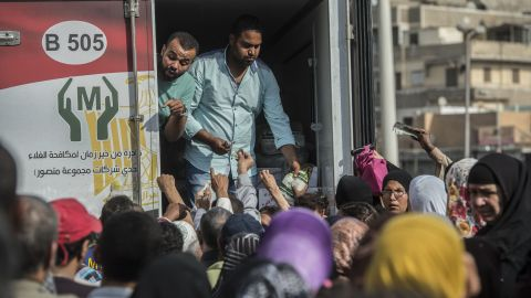 Crowds gather outside a distribution point of state-subsidized sugar in Cairo.