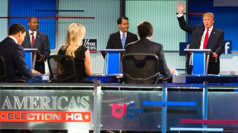 """Trump raises his hand during <a href=""""http://www.cnn.com/2015/08/07/politics/gallery/republican-debate-2-gop-presidential-2016/index.html"""" target=""""_blank"""">the first Republican debates</a> of the campaign, which took place in Cleveland on August 6, 2015. Trump kicked off the event by refusing to rule out a third-party run and pledge his support to whoever becomes the Republican nominee. He was joined on stage by nine other candidates -- seven of the lower-polling candidates <a href=""""http://www.cnn.com/2015/08/06/politics/gallery/republican-debate-1-gop-presidential-2016/index.html"""" target=""""_blank"""">had a separate debate</a> before the main event."""