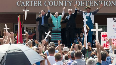 """Republican presidential candidate Mike Huckabee, left, holds hands with Kim Davis in front of a detention center in Grayson, Kentucky, on September 8, 2015. Davis, a Rowan County clerk of courts, <a href=""""http://www.cnn.com/2015/09/08/politics/kim-davis-kentucky-clerk-2016-candidates-chris-christie/index.html"""" target=""""_blank"""">spent several days in jail</a> for refusing to issue marriage licenses to same-sex couples. Huckabee latched onto Davis as a symbol of the fight against what he said is government overreach."""