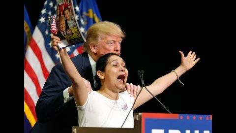 """Trump poses with a woman he brought up on stage during a rally in Las Vegas on October 8, 2015. The woman <a href=""""http://www.cnn.com/2015/10/08/politics/latino-woman-las-vegas-trump-adoring-fan/"""" target=""""_blank"""">kissed Trump</a> as she clutched a copy of his People magazine cover. """"I'm Hispanic and I vote for Mr. Trump! She said. """"We vote for Mr. Trump! Yes! Mr. Trump! We love you! We love you, all the way to the White House!"""" Trump, who had come under fire for his comments about Hispanics, seemed to understand how it might be perceived. """"I swear to you -- I think she's totally beautiful and great -- I've never met her before, I swear,"""" he said."""