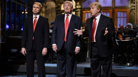 """Trump is flanked by impersonators Taran Killam, left, and Darrell Hammond during his """"Saturday Night Live"""" monologue on November 7, 2015."""