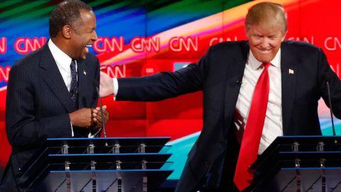 "Trump shares a laugh with fellow candidate Ben Carson during <a href=""http://www.cnn.com/2015/12/15/politics/gallery/gop-debates-las-vegas/index.html"" target=""_blank"">the Las Vegas debate.</a>"