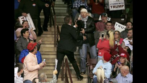 A protester is removed by security personnel during a Trump campaign event in Rock Hill, South Carolina, on January 8, 2016.