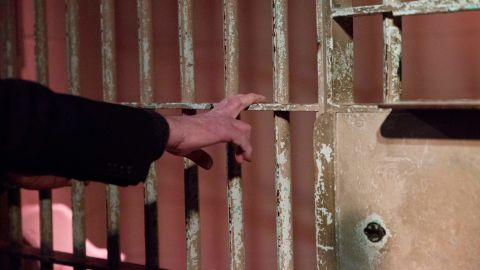 """While visiting the Civil Rights Institute in Birmingham, Alabama, on January 18, 2016, Sanders touches the actual jail bars that the Rev. Martin Luther King Jr. was behind when he wrote his """"Letter from Birmingham Jail"""" in 1963."""