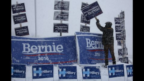 """A campaign worker brushes snow off Sanders signs in Manchester, New Hampshire, on February 5, 2016. Sanders <a href=""""http://www.cnn.com/2016/02/09/politics/new-hampshire-primary-highlights/"""" target=""""_blank"""">won the New Hampshire primary</a> a few days later."""