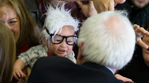 """Sanders meets a 3-month-old dressed like him at a campaign rally in Las Vegas on February 14, 2016. The boy, Oliver Jack Carter Lomas-Davis, <a href=""""http://www.cnn.com/2016/03/03/politics/bernie-baby-dies/index.html"""" target=""""_blank"""">died from Sudden Infant Death Syndrome</a> a few weeks later."""