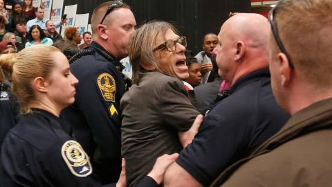 """Christopher Morris, a photographer on assignment for Time magazine, is escorted by police during a Trump rally in Radford, Virginia, on February 29, 2016. Morris said a Secret Service agent choked him and slammed him to the ground as he tried to leave a media pen at the event. <a href=""""http://www.cnn.com/2016/02/29/politics/donald-trump-event-protest-rally/"""" target=""""_blank"""">The incident was caught on video.</a>"""