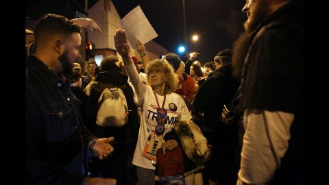 """Trump supporter Birgitt Peterson argues with protesters outside a canceled Trump rally in Chicago on March 11, 2016. Peterson <a href=""""http://www.chicagotribune.com/news/ct-birgitt-peterson-trump-rally-met-0313-20160312-story.html"""" target=""""_blank"""" target=""""_blank"""">told the Chicago Tribune</a> that she responded with a Nazi-style salute after anti-Trump protesters called her a Nazi. Trump's campaign <a href=""""http://www.cnn.com/2016/03/11/politics/donald-trump-chicago-protests/"""" target=""""_blank"""">postponed the rally</a> amid fights between supporters and demonstrators, protests in the streets and concerns that the environment at the event was no longer safe."""
