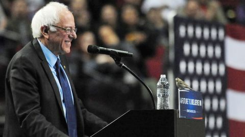 """Sanders smiles at a bird after <a href=""""http://www.cnn.com/2016/03/26/politics/bernie-sanders-bird-drawing-together/"""" target=""""_blank"""">it landed on his podium</a> in Portland, Oregon, on March 25, 2016."""