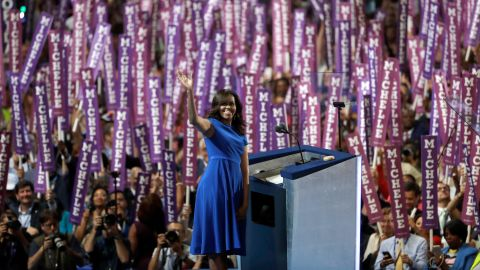 """First lady Michelle Obama waves to delegates in Philadelphia as <a href=""""http://www.cnn.com/2016/07/25/politics/michelle-obama-dnc-speech/index.html"""" target=""""_blank"""">she speaks on the first day of the Democratic National Convention</a> on July 25, 2016. Obama cast the presidential race as one between a positive role model for children and a damaging one."""