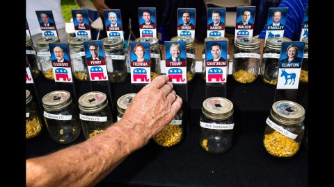 """People at <a href=""""http://www.cnn.com/2015/08/15/politics/gallery/iowa-state-fair-postcards/index.html"""" target=""""_blank"""">the Iowa State Fair</a> use corn kernels to show support for their favorite presidential candidates on August 13, 2015. Many candidates attended the fair, mingling with voters in the first-in-the-nation caucus state."""