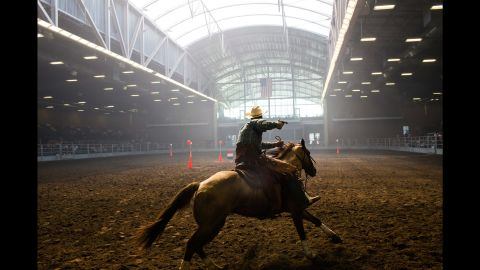 """Brian Bolton, from Creston, Iowa, participates in a mounted shooting competition at the Iowa State Fair on August 14, 2015. Photographer Landon Nordeman <a href=""""http://www.cnn.com/2015/08/15/politics/gallery/iowa-state-fair-postcards/index.html"""" target=""""_blank"""">visited the fair</a> in search of presidential candidates and interesting people."""