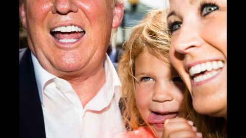 """Trump poses for a picture with a woman and child at <a href=""""http://www.cnn.com/2015/08/15/politics/gallery/iowa-state-fair-postcards/index.html"""" target=""""_blank"""">the Iowa State Fair</a> on August 15, 2015."""