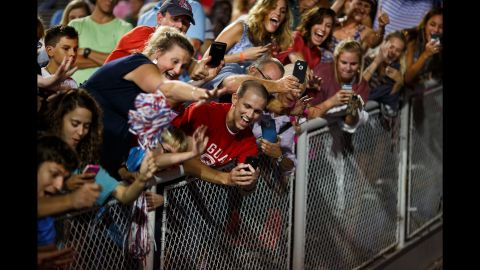 """Trump supporters take photos of Trump as he leaves a rally in Mobile, Alabama, on August 21, 2015. The rally <a href=""""http://www.cnn.com/2015/08/22/politics/gallery/trump-rally-alabama/index.html"""" target=""""_blank"""">was held in a football stadium</a> to accommodate 30,000 supporters."""