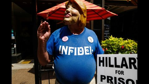 """A protester wears a Hillary Clinton mask <a href=""""http://www.cnn.com/2016/07/20/politics/gallery/outside-rnc-van-agtmael/index.html"""" target=""""_blank"""">outside the Republican National Convention.</a> CNN sent photographer Peter van Agtmael into the crowds of both conventions to get a handle on what it's like away from the politicians and delegates."""