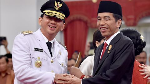 Indonesian President Joko Widodo with Ahok after the latter's swearing in as governor on November 19, 2014.