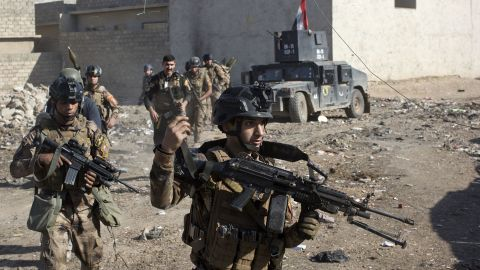 Iraqi soldiers patrol an alley on the outskirts of Mosul on Friday, November 4.