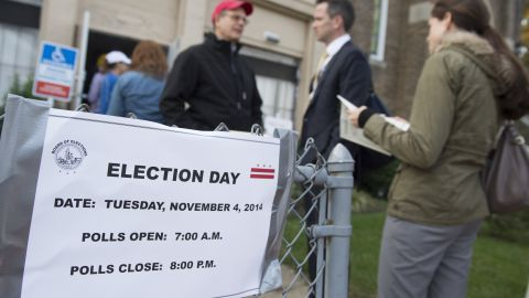 Voters line up to cast their ballots at a polling station in Washi