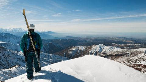 Skier standing on a peak at Oukaimeden resort in the Atlas mountains.