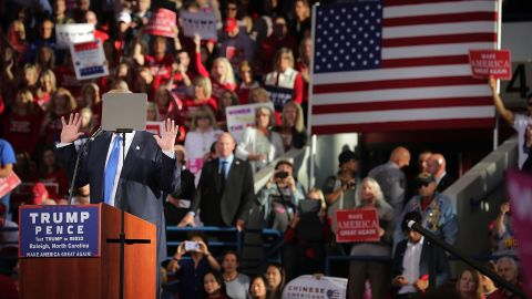 Trump's face is obscured by a teleprompter as he holds his campaign rally in Raleigh on November 7.