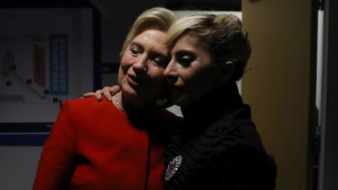 Clinton greets Lady Gaga backstage after the campaign event in Raleigh on November 8. The singer urged the crowd to make history and elect the first woman president.
