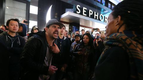 Trump and Clinton supporters clash in New York's Times Square after Trump's victory was declared on November 9.