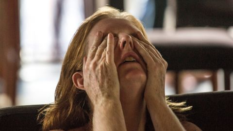 An expatriate Democratic supporter weeps in a restaurant in Phnom Penh, Cambodia, as the election is called in Trump's favor on November 9.