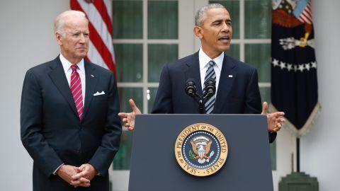 President Barack Obama, accompanied by Vice President Joe Biden, speaks in the election, Wednesday, Nov. 9, 2016, in the Rose Garden of the White House in Washington.