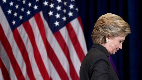 TOPSHOT - US Democratic presidential candidate Hillary Clinton steps down a staircase after making a concession speech following her defeat to Republican President-elect Donald Trump, in New York on November 9, 2016. / AFP / JEWEL SAMAD        (Photo credit should read JEWEL SAMAD/AFP/Getty Images)