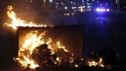 Debris burns in the street during a protest that took place in Oakland, California, after news of Trump's victory.